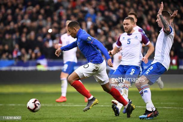 France's forward Kylian Mbappe shoots to score the 30 goal during the UEFA Euro 2020 Group H qualification football match between France and Iceland...