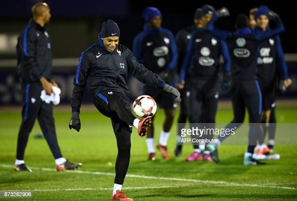 TOPSHOT France's forward Kylian Mbappe takes part in a training session in ClairefontaineenYvelines on November 12 as part of the team's preparation...
