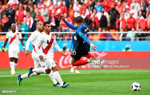 TOPSHOT France's forward Kylian Mbappe trys a back hell shot during the Russia 2018 World Cup Group C football match between France and Peru at the...