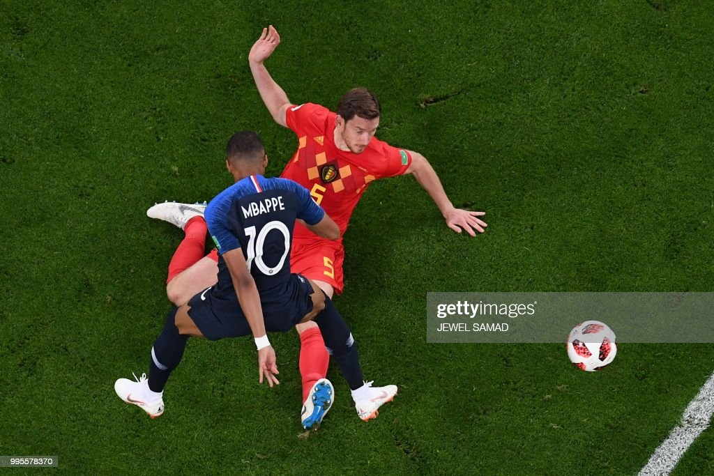 France's forward Kylian Mbappe (front C) vies for the ball with Belgium's defender Jan Vertonghen (rear R) as he eyes the ball during the Russia 2018 World Cup semi-final football match between France and Belgium at the Saint Petersburg Stadium in Saint Petersburg on July 10, 2018. (Photo by Jewel SAMAD / AFP) / RESTRICTED