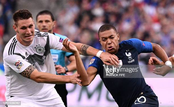 France's forward Kylian Mbappe vies with Germany's defender Niklas Sule during the UEFA Nations League football match between France and Germany at...