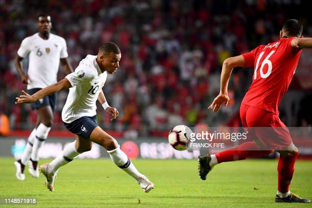 France's forward Kylian Mbappe vies with Turkey's defender Merih Demiral during the Euro 2020 football qualification match between Turkey and France...