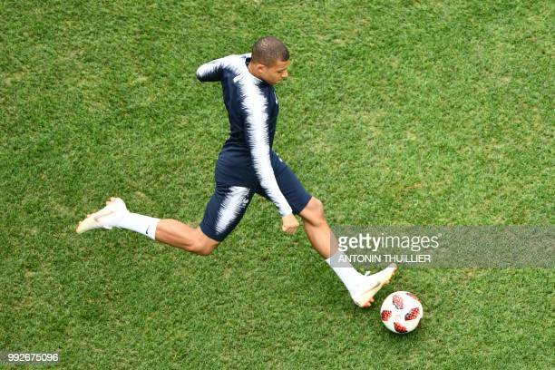 TOPSHOT France's forward Kylian Mbappe warms up ahead of the Russia 2018 World Cup quarterfinal football match between Uruguay and France at the...