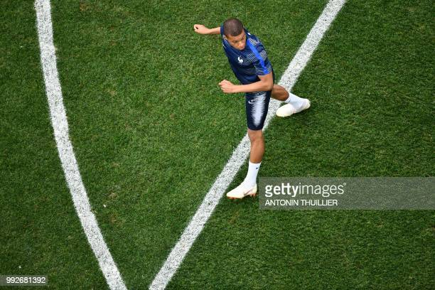 France's forward Kylian Mbappe warms up ahead of the Russia 2018 World Cup quarterfinal football match between Uruguay and France at the Nizhny...