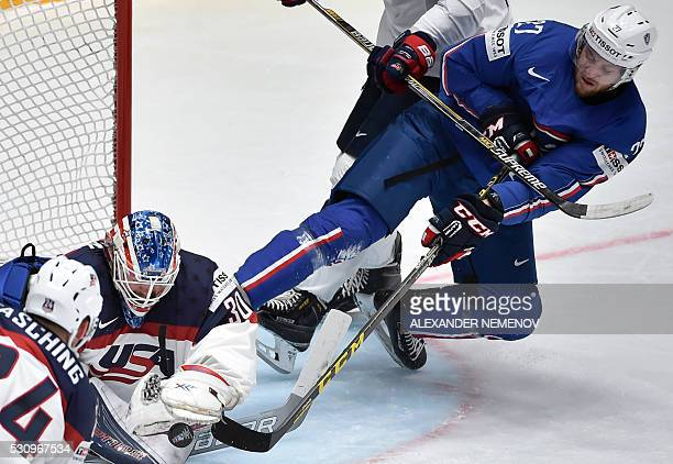 France's forward Loic Lamperier attacks US goalie Mike Condon during the group B preliminary round game USA vs France at the 2016 IIHF Ice Hockey...