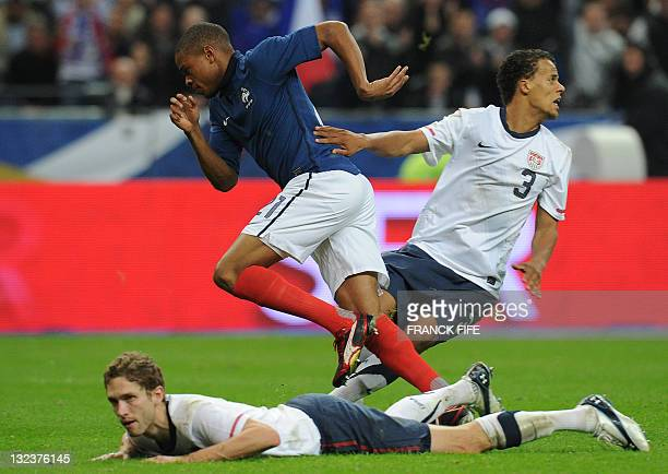 France's forward Loic Remy reacts afer scoring a goal next to US defender Maurice Edu during the friendly football match France v. USA on November...
