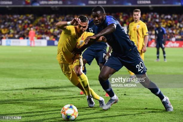 France's forward Marcus Thuram and Romania's defender Cristian Manea go for the ball during the Group C match of the U21 European Football...