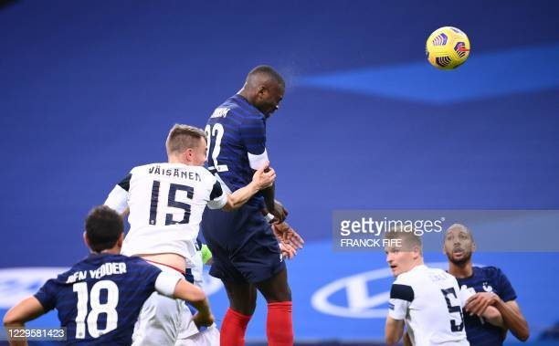France's forward Marcus Thuram heads the ball and hits the goal post during the friendly football match between France and Finland at the Stade de...