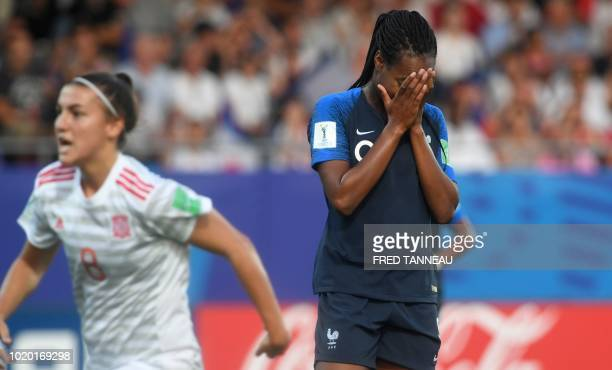 France's forward MarieAntoinette Katoto reacts after missing a penalty during the Women's U20 World Cup semifinal football match between France and...