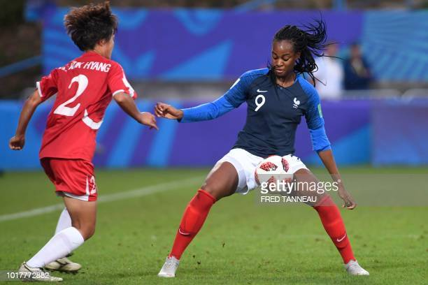 France's forward MarieAntoinette Katoto vies for the ball against Korea DPR's midfielder Kuk Hyang An during the Women's World Cup 2018 U20 football...