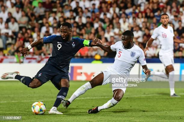 France's forward Moussa Dembele shoots on goal despite England's Fikayo Tomori during the Group C match of the U21 European Football Championships...