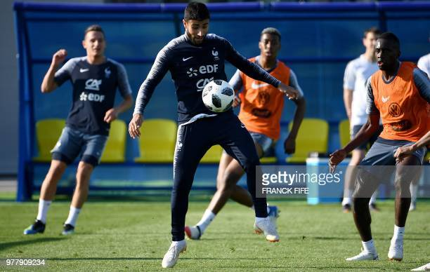 France's forward Nabil Fekir controls the ball during a training session at the Glebovets stadium in Istra west of Moscow on June 18 ahead of their...