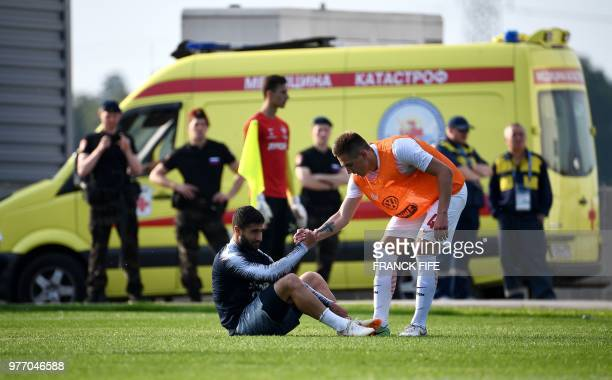 France's forward Nabil Fekir is helped up during the friendly football match against a selection of 19yearold players from Spartak Moscow at the...