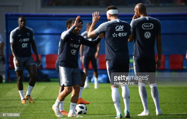 France's forward Nabil Fekir jokes with France's forward Olivier Giroud during a friendly football match against a selection of 19yearold players...