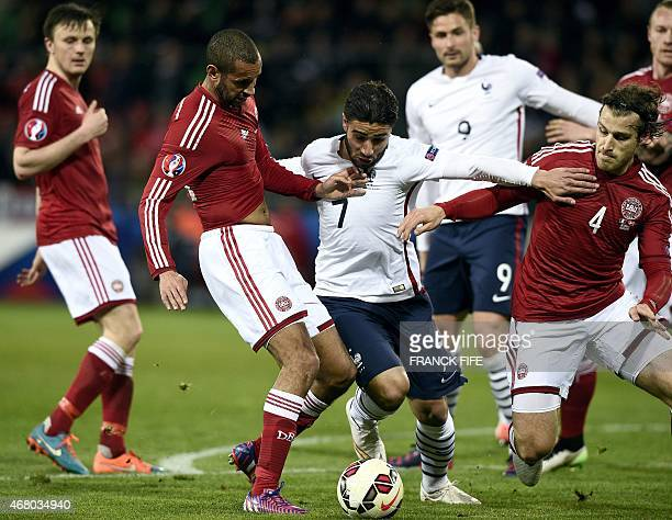 France's forward Nabil Fekir vies with Denmark's Simon Busk Poulsen and Denmark's defender Erik Sviatchenko during the friendly football match...