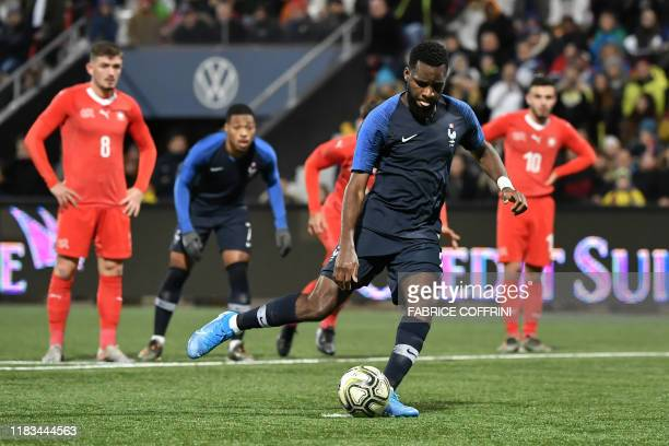 France's forward Odsonne Edouard shoots from the penalty spot to score his team's first goal during the UEFA Under 21 Euro 2021 qualifying football...