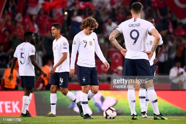 France's Forward Olivier Giroud and France's forward Antoine Griezmann react after Turkey's scoring their second goal during the Euro 2020 football...