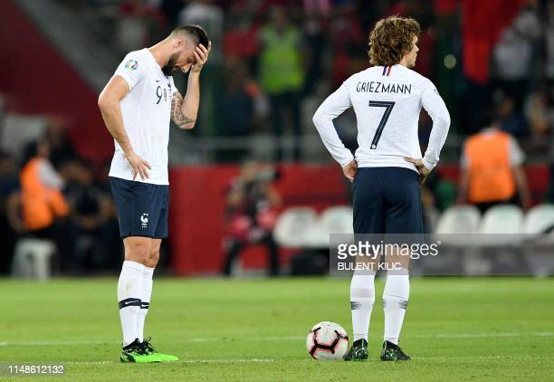 France's Forward Olivier Giroud , and France's forward Antoine Griezmann react after Turkey's scoring their second goal during the Euro 2020 football...