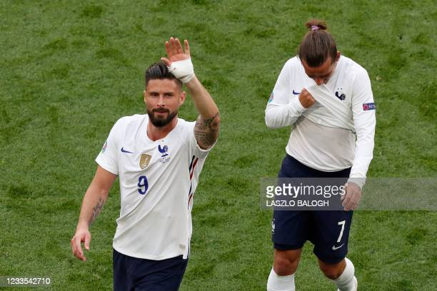 France's forward Olivier Giroud and France's forward Antoine Griezmann react after the UEFA EURO 2020 Group F football match between Hungary and...