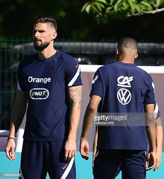 France's forward Olivier Giroud and France's forward Kylian Mbappe take part in a training session at the team's training grounds in...