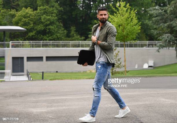 France's forward Olivier Giroud arrives in ClairefontaineenYvelines on June 4 as part of the team's preparation for the upcoming FIFA Football World...