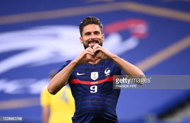 France's forward Olivier Giroud celebrates after scoring a goal during the International friendly football match between France and Ukraine, on...