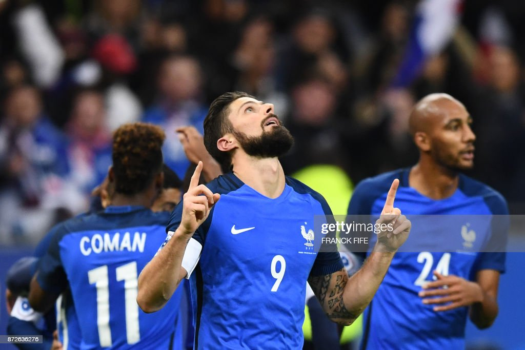 France's forward Olivier Giroud (C) celebrates after scoring a goal during the friendly football match between France and Wales at the Stade de France stadium, in Saint-Denis, on the outskirts of Paris, on November 10, 2017. /