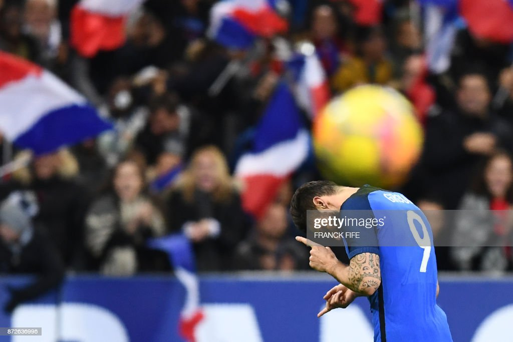 France's forward Olivier Giroud celebrates after scoring a goal during the friendly football match between France and Wales at the Stade de France stadium, in Saint-Denis, on the outskirts of Paris, on November 10, 2017. /