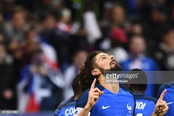 France's forward Olivier Giroud celebrates after scoring a goal during the friendly football match between France and Wales at the Stade de France...