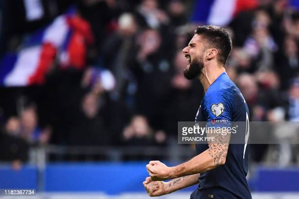 TOPSHOT France's forward Olivier Giroud celebrates after scoring a goal with teammates during the Euro 2020 Group H football qualification match...