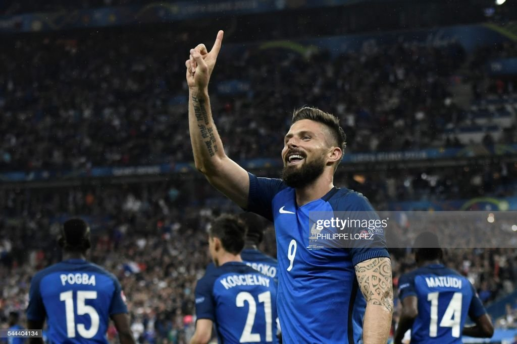 TOPSHOT - France's forward Olivier Giroud celebrates after scoring another goal during the Euro 2016 quarter-final football match between France and Iceland at the Stade de France in Saint-Denis, near Paris, on July 3, 2016. /
