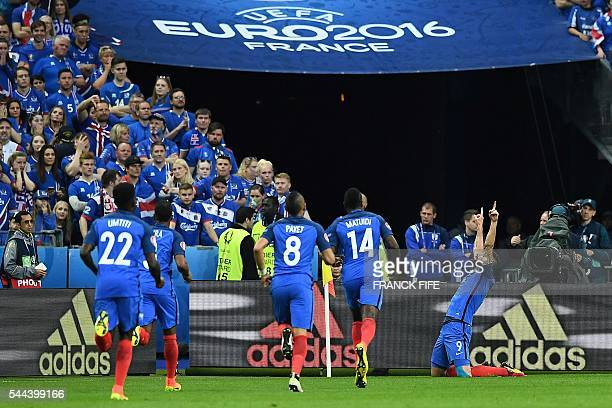 France's forward Olivier Giroud celebrates after scoring France's first goal of the match during the Euro 2016 quarterfinal football match between...