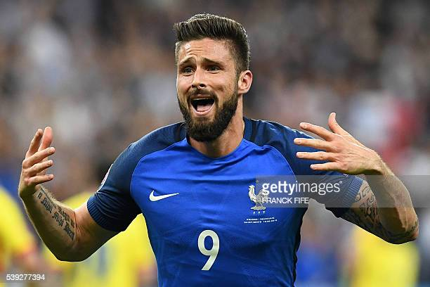 France's forward Olivier Giroud celebrates after scoring the 1-0 during the Euro 2016 group A football match between France and Romania at Stade de...
