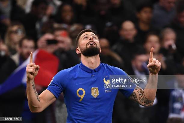 France's forward Olivier Giroud celebrates after scoring the 2-0 goal during the UEFA Euro 2020 Group H qualification football match between France...