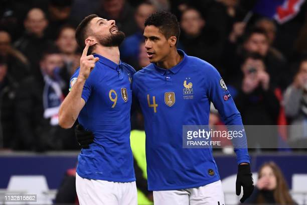 France's forward Olivier Giroud celebrates after scoring the 2-0 goal with France's defender Raphael Varane during the UEFA Euro 2020 Group H...