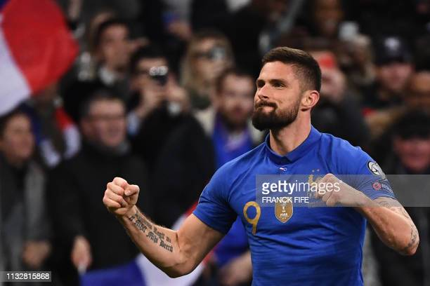 TOPSHOT France's forward Olivier Giroud celebrates after scoring the 20 goal during the UEFA Euro 2020 Group H qualification football match between...