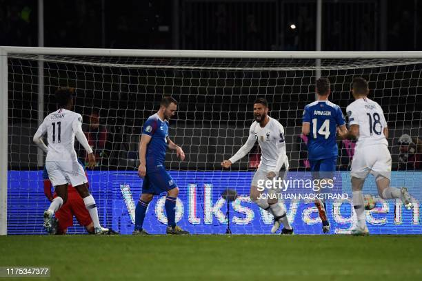 France's forward Olivier Giroud celebrates scoring the opening goal from the penalty spot during the UEFA Euro 2020 qualifier Group H football match...