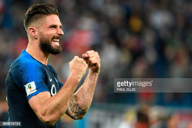 TOPSHOT France's forward Olivier Giroud celebrates the team's victory in the Russia 2018 World Cup semifinal football match between France and...