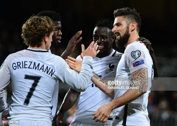 France's forward Olivier Giroud celebrates with France's forward Antoine Griezmann after scoring during the FIFA World Cup 2018 qualifying football...