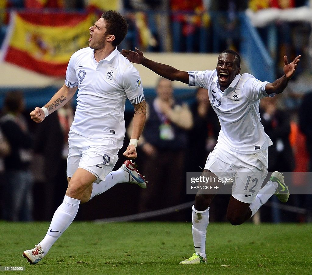 France's forward Olivier Giroud (L) celebrates with France's midfielder Blaise Matuidi after scoring the equalising goal at the end of the FIFA World Cup 2014 qualifying football match Spain vs France on October 16, 2012 at Vicente Calderon stadium in Madrid. The game ended in a draw 1-1.