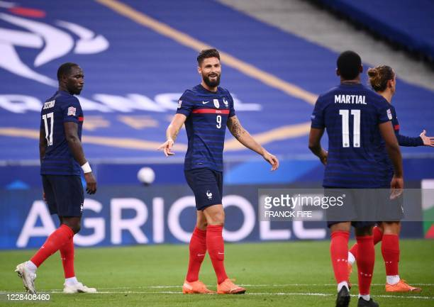 France's forward Olivier Giroud celebrates with team mates after scoring a goal during the UEFA Nations League Group C football match between France...