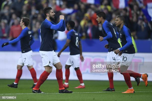 France's forward Olivier Giroud celebrates with teammates after scoring a goal during the friendly football match between France and Colombia at the...