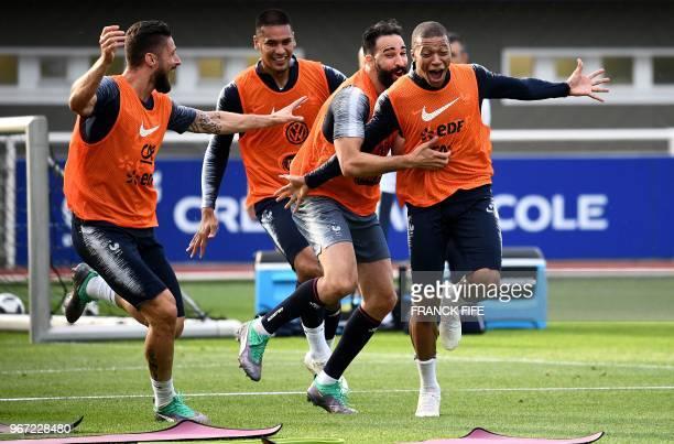 TOPSHOT France's forward Olivier Giroud France's goalkeeper Alphonse Aerola France's defender Adil Rami and France's forward Kylian Mbappe react...