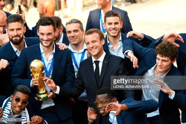 TOPSHOT France's forward Olivier Giroud France's goalkeeper Hugo Lloris French president Emmanuel Macron France's midfielder Paul Pogba France's...