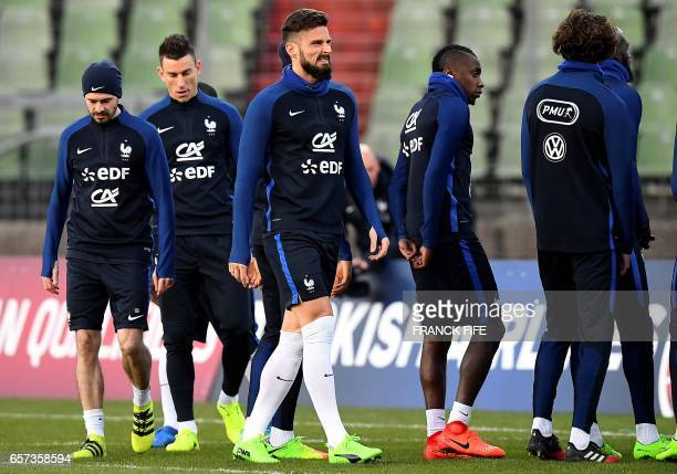 France's forward Olivier Giroud grimaces during a training session of France's national football team at the Josy Bartel stadium in Luxembourg on...