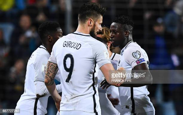 France's forward Olivier Giroud is congratulated by teammates after scoring a goal during the FIFA World Cup 2018 qualifying football match...