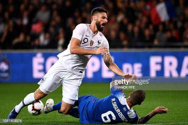 France's forward Olivier Giroud is tackled by Iceland's defender Ragnar Sigurdsson during the friendly football match between France and Iceland at...