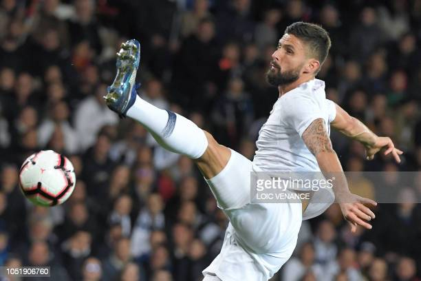 France's forward Olivier Giroud jumps for the ball during the friendly football match between France and Iceland at the Roudourou Stadium in Guingamp...