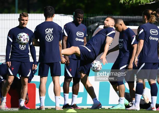France's forward Olivier Giroud kicks the ball during a training session at the team's training grounds in Clairefontaine-en-Yvelines, southwest of...