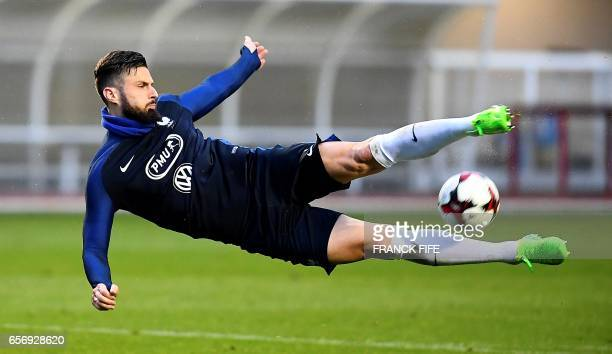France's forward Olivier Giroud kicks the ball during a training session in Clairefontaine on March 23 near Paris as part of the team's preparation...